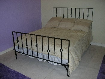Cage wrought iron bed